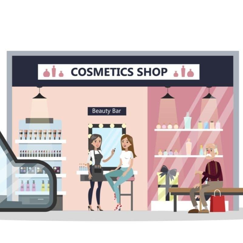 化粧品売り場で店員に相談する女性